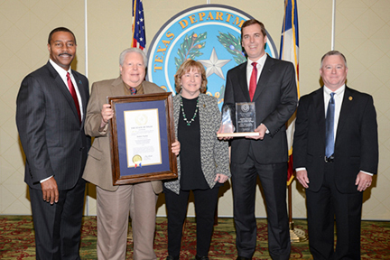 From left to right: TBCJ Chairman Dale Wainwright, Mr. Taylor, Debra Taylor, Supreme Court Justice Jimmy Blacklock, and TDCJ Executive Director Bryan Collier.