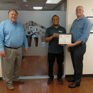 Shown (left to right) are WSD Superintendent Dr. Clint Carpenter and Dallas Area Habitat for Humanity's Program Administrator Bryant Aragon and CEO William D. Hall.