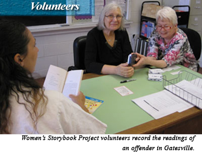 Womens Storybook Project volunteers record the readings of an offender in Gatesville.
