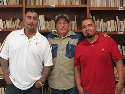 Career ready:  Austin-area welders Candelario Davila (left) and Jose Sanchez express appreciation for WSD vocational teacher Jimmy Perry.  A veteran teacher of WSD, Perry trains his students in advanced welding skills, acting as a role model while challenging them to succeed after release from TDCJ.
